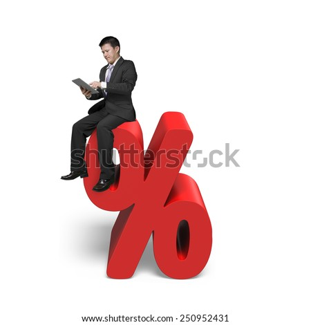 Using tablet businessman sitting on red percentage sign with white background - stock photo