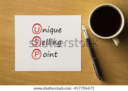 USP Unigue selling point- handwriting on paper with cup of coffee and pen, acronym business concept