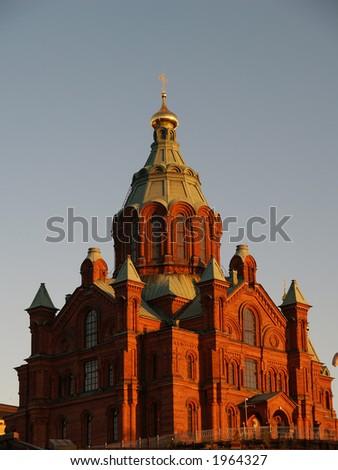 Uspenski Cathedral in Helsinki at sunset, close-up - stock photo