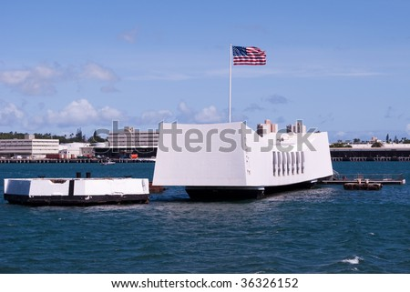 USS Arizona Memorial with US flag flying patriotically, honoring the lives lost December 7th 1941 at 7:53 am. Pearl Harbor, Oahu Hawaii 2009. - stock photo
