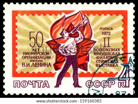 USSR-CIRCA 1972: A post stamp printed in USSR and shows Pioneer and pioneer sign,  circa 1972.  - stock photo
