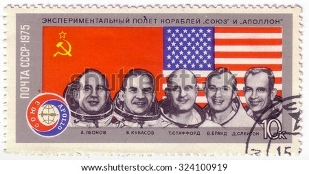 USSR - CIRCA 1975: A postage stamp printed in the USSR shows Apollo Soyuz Test Project - portrait astronauts Slayton, Brand,Stafford, Kubasov, Leonov, circa 1975 - stock photo