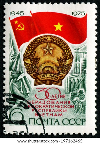 USSR - CIRCA 1975: a stamp printed by USSR shows Flag USSR and Flag and Arms to North Viet Nam, 30th anniversary , circa 1975 - stock photo