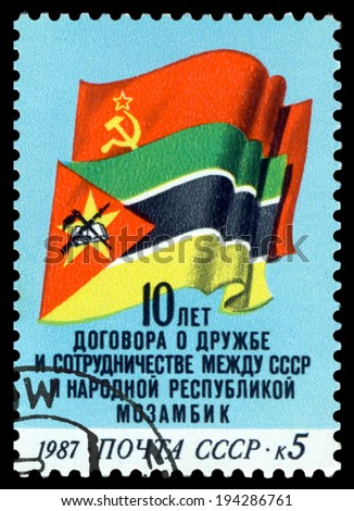 USSR- CIRCA 1987: a stamp printed by USSR, shows  Flags and Symbols  of USSR and  Mozambique, Friendship  and cooperation,  USSR and  Mozambique, circa 1987. - stock photo