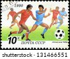 USSR - CIRCA 1990: a stamp printed by USSR shows football players. World football cup in Italy, series, circa 1990 - stock photo