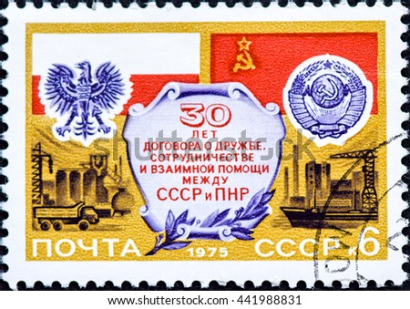 USSR - CIRCA 1975: A stamp printed in the USSR devoted 30 years friendship treaty_ cooperation and mutual aid between the USSR and Poland, circa 1975 - stock photo