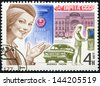 USSR - CIRCA 1977: A stamp printed in the USSR, mail USSR, seizure of letters, 4 koppeyki, girl portrait postman, carries mail, about 1977, circa 1977 - stock photo