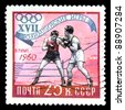 "USSR - CIRCA 1960: A stamp printed in the USSR (Russia) shows a boxing with the inscription and name of a series ""XVII Olympic Games, Rim, 1960"", circa 1960 - stock photo"