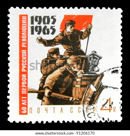 "USSR - CIRCA 1965: A stamp printed in the USSR (Russia) shows Fighters on barricades with red flag with inscription and name of series ""60 years of the first Russian Revolution of 1905"", circa 1965"