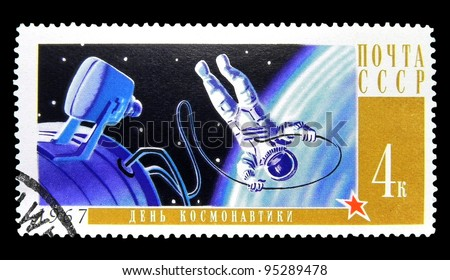 "USSR - CIRCA 1967: A stamp printed in the USSR (Russia) shows Russian cosmonaut Leonov in open space with the inscription and the name of series ""Cosmonauts Day"", circa 1967"