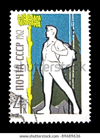 "USSR - CIRCA 1962: A stamp printed in the USSR (Russia) shows Tourist with the inscription ""For the good of the people"" from the series ""The Russian People"", circa 1962"