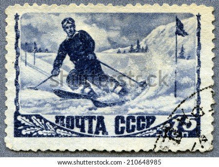USSR - CIRCA 1945: A stamp printed in the USSR showing skier, circa 1945  - stock photo
