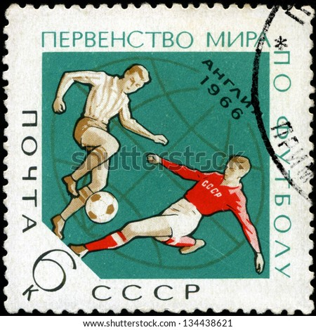 "USSR - CIRCA 1966: A stamp printed in the USSR  shows a football players with the inscription and name of a series ""Football World Cup, England, 1966�¢?�, circa 1966 - stock photo"