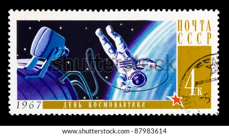 USSR - CIRCA 1967: A stamp printed in the USSR shows cosmonaut in open space, circa 1967 - stock photo