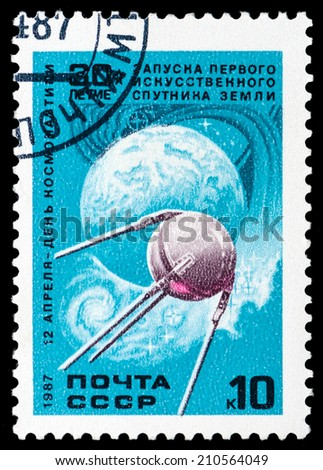 USSR - CIRCA 1987: A stamp printed in the USSR shows first artificial Earth satellite, circa 1987 - stock photo