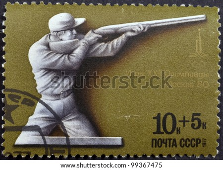 USSR - CIRCA 1977: A stamp printed in the USSR shows Games XXII Olympiad Moscow 1980-shooting, circa 1977 - stock photo