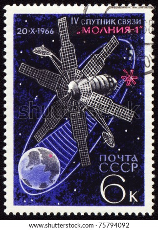USSR - CIRCA 1966: A stamp printed in the USSR shows soviet communication satellite Molnia-1 on Earth orbit, circa 1966 - stock photo