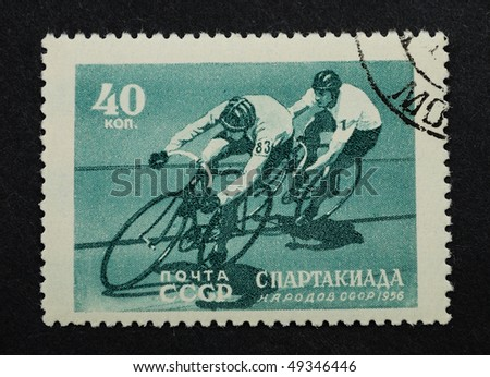 "USSR - CIRCA 1956: A Stamp printed in the USSR shows the bicycle sports. The series name ""Sports and athletics meeting the people of the USSR"", circa 1956"