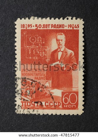 USSR - CIRCA 1945: A Stamp printed in the USSR shows the inventor of radio A.S.Popov,  A.S.Popov at the first-ever radio receiver, circa 1945 - stock photo