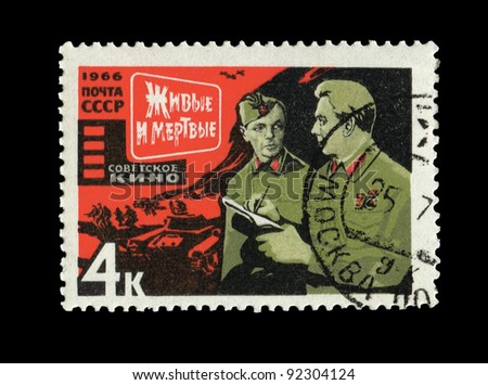 "USSR - CIRCA 1966: A stamp printed in the USSR shows The Soviet movie ""Live and dead"", circa 1966"