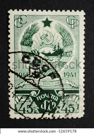 USSR - CIRCA 1941: A Stamp printed in the USSR shows the State Emblem of the Karelo-Finnish Soviet Socialist Republic, circa 1941