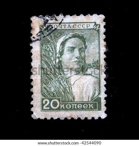 USSR - CIRCA 1953: A stamp printed in the USSR shows  woman harvester, circa 1953