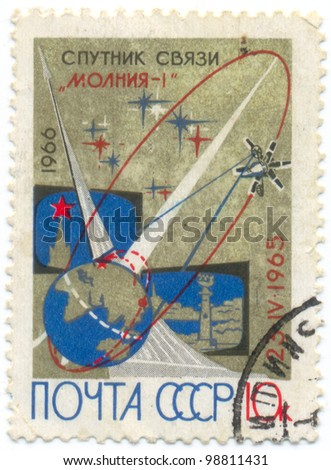 USSR - CIRCA 1966: A stamp printed in the USSR which shows soviet communication satellite Molnia-1 on Earth orbit in space, circa 1966 - stock photo