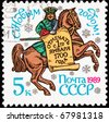 USSR - CIRCA 1989: A Stamp printed in USSR a man on horseback holding a banner, circa 1989.  Commemoration of Peter the Great's 1700 New Year's decree which changed Russia to the Julian calendar. - stock photo