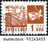 """USSR - CIRCA 1966: A stamp printed in USSR from the """"Society and Technology"""" issue shows the Palace of Congresses, Kremlin and communism emblem with map, circa 1966. - stock"""