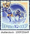 "USSR - CIRCA 1960: A stamp printed in USSR from the ""Winter Olympic Games, Squaw Valley, California"" issue shows an ice hockey game, circa 1960. - stock photo"