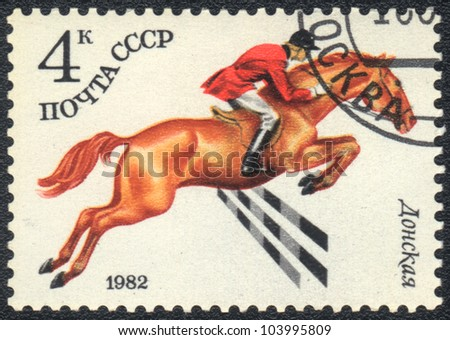 USSR - CIRCA 1982: A stamp printed in USSR shows  a  Donskaya horse racing , series horse breed in a equestrian sport, circa 1982 - stock photo