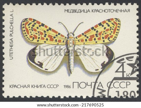 USSR - CIRCA 1986: A stamp printed in USSR, shows Butterfly Utetheisa pretty Utetheisa pulchella , from series Red Book USSR, circa 1986. - stock photo