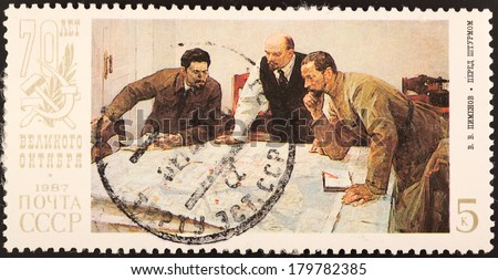 USSR - CIRCA 1987: A stamp printed in USSR shows country head Lenin with his friends, circa 1987 - stock photo