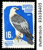 """USSR - CIRCA 1964: A Stamp printed in USSR shows image of a Lammergeier from the series """"100th anniv. of the Moscow zoo"""", circa 1964 - stock photo"""