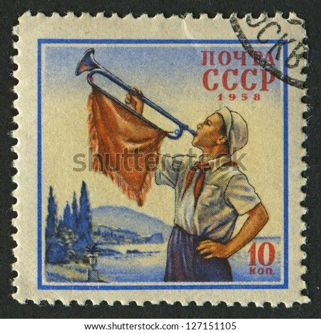 USSR - CIRCA 1958: A stamp printed in USSR shows image of Pionier with trumpet, circa 1958.