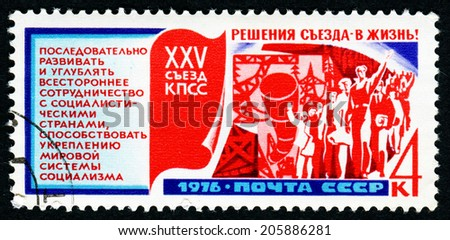 """USSR - CIRCA 1976: A stamp printed in USSR shows """"International cooperation"""" with inscription """"Decisions of Congress - in life"""" series """"25 Congress of Communist Party of Soviet Union"""", circa 1976 - stock photo"""