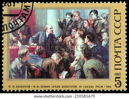 USSR - CIRCA 1987: A stamp printed in USSR, shows Lenin with Delegates at the 3rd Congress of the Soviet Young Communist League, circa 1987 - stock photo