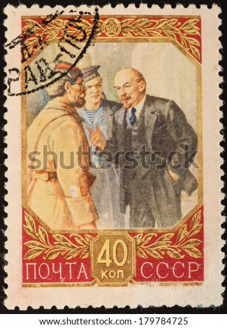 USSR - CIRCA 1945: A stamp printed in USSR shows portret of coutry head with friends, name Lenin, circa 1945 - stock photo