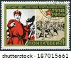 USSR - CIRCA 1968: A stamp printed in USSR shows 1918 poster and marching volunteers, series 50th anniversary of the Armed Forces of the USSR, circa 1968 - stock photo