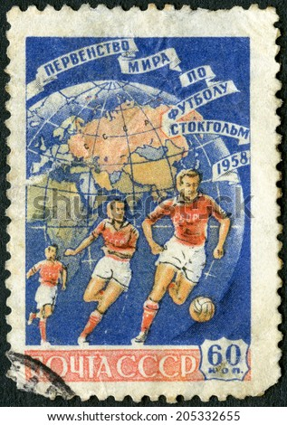 USSR - CIRCA 1958: A stamp printed in USSR shows Soccer Players and Globe, World Cup Soccer Championship, Stockholm, 1958, circa 1958 - stock photo