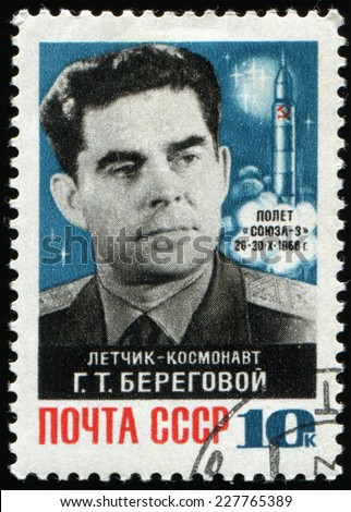 USSR - CIRCA 1968: A stamp printed in USSR shows soviet cosmonaut Georgy Beregovoy and spaceship Soyuz-3, circa 1968  - stock photo
