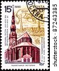 USSR - CIRCA 1990: A stamp printed in USSR shows St. Peter's Church in Riga, Latvia which dates from 1209, circa 1990. - stock photo