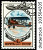 "USSR - CIRCA 1977: A Stamp printed in USSR shows the Aviation Emblem and P-4 BIS biplane (1917), from the series ""Aviation 1917-1930"", circa 1977. - stock photo"