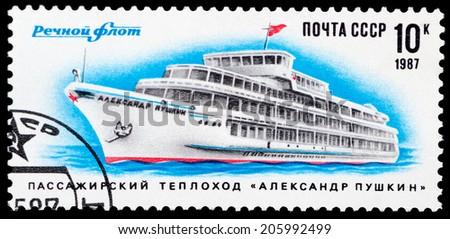 "USSR - CIRCA 1987: A stamp printed in USSR shows the passenger motor ship ""Alexander Pushkin"", circa 1987 - stock photo"