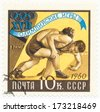 USSR - CIRCA 1960: A stamp printed in USSR shows wrestlers, series Rome Olympics, circa 1960 - stock