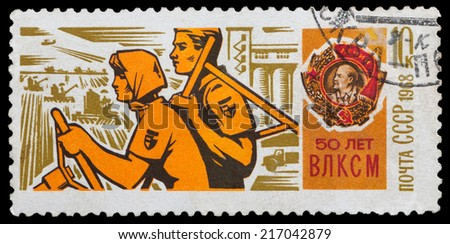 USSR - CIRCA 1968: A stamp printed in USSR, shows young workers and Order of Lenin, devoted to the 50-th anniversary of Komsomol, circa 1968 - stock photo
