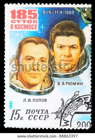 USSR - CIRCA 1981: An airmail stamp printed in USSR shows a space ship and spacemans: L.Popov and V.Rumin, series, circa 1981. - stock photo