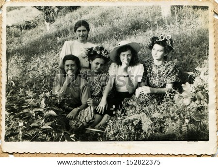 USSR - CIRCA 1951: An antique photo shows five young women are resters of SPA Sovetskiy, Grozniy, Chechnia, 1951