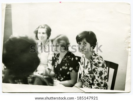 USSR - CIRCA 1980: An antique photo shows students at the table - stock photo