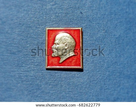 "USSR - CIRCA 1974: Badge with the image of Vladimir Lenin (Ulyanov) from the series ""Vladimir Lenin"". Closeup. Faleristics. Low DOF photography"